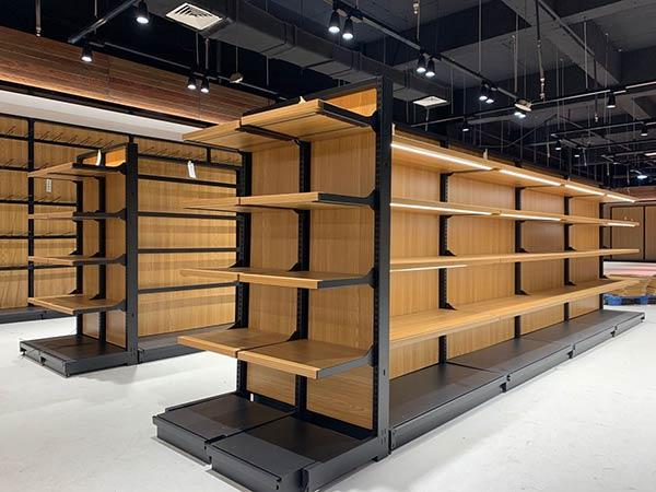 双面超市钢木货架安装效果图
